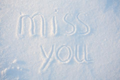 The word miss you draw on snow Stock Photography