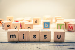 Word ` miss you ` wood Cubic on the wood.  Stock Image