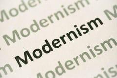 Word Modernism printed on paper macro. Word Modernism printed on white paper macro stock photos