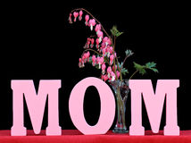 The word MOM  on black Royalty Free Stock Image