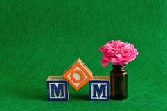 The word mom spelled with alphabet blocks Stock Photos