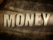 The word Money on paper background Stock Photos