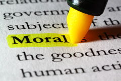 Word moral highlighted with a yellow marker. Closeup of the word moral highlighted with a yellow marker Royalty Free Stock Photo