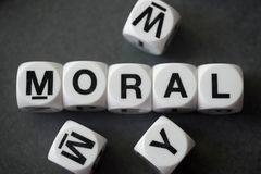 Word moral on toy cubes. Word moral on white toy cubes Royalty Free Stock Image