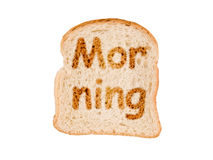 Word  morning written on a toasted slice of bread Stock Photo