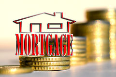 """The word """"mortgage"""" in the background the columns of coins. The word """"mortgage"""" in the background the columns of coins Royalty Free Stock Photo"""