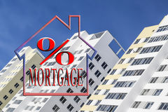 """The word """"mortgage"""" in the background of new homes. The word """"mortgage"""" in the background of new homes Royalty Free Stock Photography"""