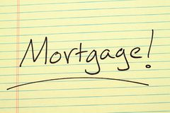 Mortgage! on a yellow legal pad. The word `Mortgage!` underlined on a yellow legal pad Stock Photo