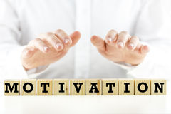 The word Motivation on wooden blocks or cubes Royalty Free Stock Photo