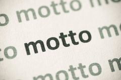 Word motto op document macro wordt gedrukt die stock fotografie