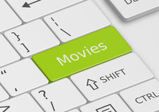 The word Movies written on the keyboard. The word Movies written on a green key from the keyboard Royalty Free Stock Image