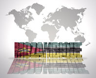 Word Mozambique on a world map background. Word Mozambique with Mozambican Flag on a world map background Stock Images