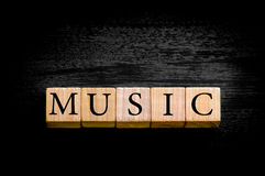 Word MUSIC isolated on black background with copy space Royalty Free Stock Photos