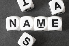 Word name on toy cubes. Word name on white toy cubes Stock Images