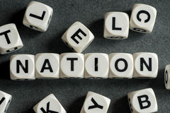 Word nation on toy cubes Royalty Free Stock Image