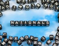 The word Nationals. On the sky background Stock Photos