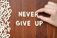 Word never give up made with block wooden letters Royalty Free Stock Photo