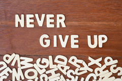 Word never give up made with block wooden letters Stock Photos