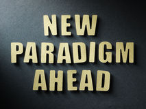The word New Paradigm Ahead on paper background Royalty Free Stock Images