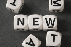 Word new on toy cubes Royalty Free Stock Photos