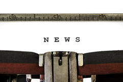 The word News. Printed on an old typewriter Royalty Free Stock Images