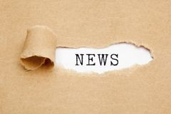 News Torn Paper Concept. Word News appearing behind ripped brown paper. Media press information concept stock photos