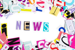 Word NEWS from newspaper letters Royalty Free Stock Images