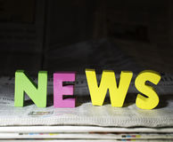 Word news on newspaper Stock Photos