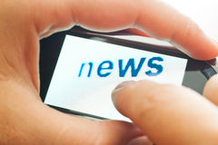 Word news on touch device Royalty Free Stock Photos