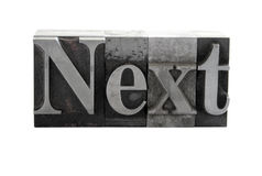 The word 'Next' in metal type. Old, ink-stained metal letterpress type spells out the word 'Next' isolated on white stock photos
