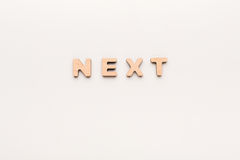Word Next on white background. Continued, success, challenge concept Stock Photos