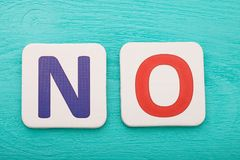 Word no on blue wooden background. Copy space. Top view. Mock up. Word no on blue wooden background. Copy space. Top view. Mock up Stock Photography