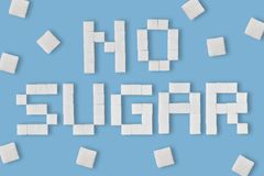Word No sugar written with sugar cubes royalty free stock photo
