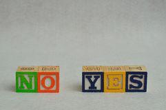 The word no and yes spelled with colorful alphabet blocks Stock Image