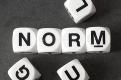 Word norm on toy cubes. Word norm on white toy cubes Royalty Free Stock Image