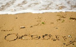 Word Ocean written on the sand Royalty Free Stock Photography