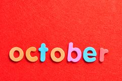 October on a red background Royalty Free Stock Images