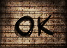 Word ok on red brick wall Stock Image