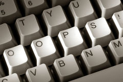The Word Oops on Special Computer Keyboard. The word oops with an exclamation mark spelled with modified keys on a special computer keyboard as a metaphor for a Royalty Free Stock Photos
