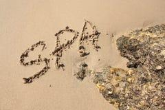 Word op het strand Stock Fotografie