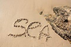 Word op het strand Stock Foto's