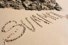 Word op het zandige strand Stock Fotografie