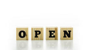 The word Open on four natural wooden cubes Stock Image