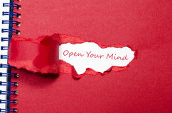 The word open your mind appearing behind torn paper Stock Images