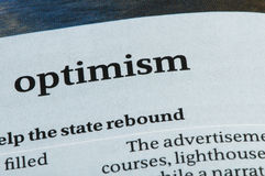 Word Optimism. On newspaper. Studio shot Stock Images