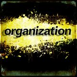 Word `organization` on black and yellow grunge background. Royalty Free Stock Photo