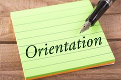 The word orientation. Written in stick memo with fountain pen on wood Stock Images