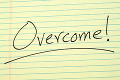 Overcome! On A Yellow Legal Pad. The word `Overcome!` underlined on a yellow legal pad stock photos