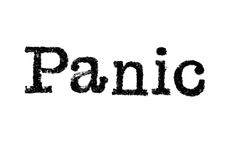 The word `Panic` from a typewriter on white Stock Images
