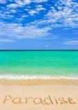 Word Paradise on beach Royalty Free Stock Photos